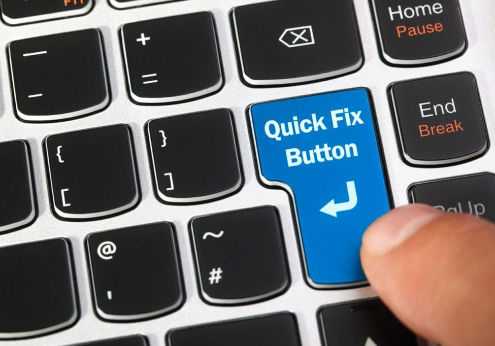 Computer keyboard enter key with a magic quick fix button concept for it support, technical assistance and customer service